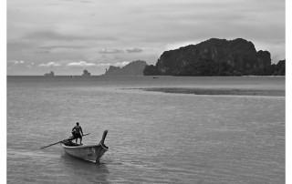 Man driving long tail boat, Ao Nammao. Krabi Province, Thailand